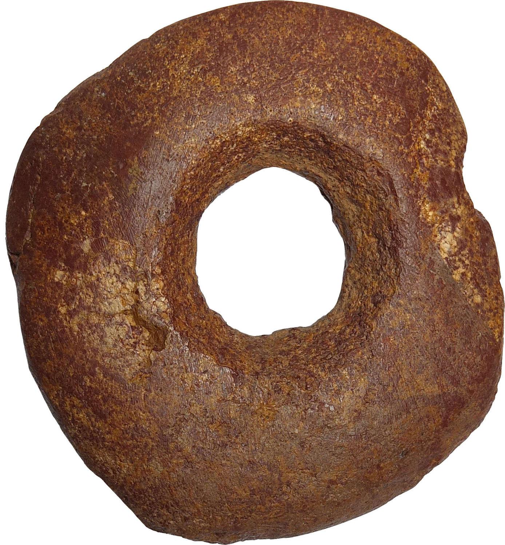 An Egyptian Neolithic discoidal macehead, c. 4th Millennium B.C.