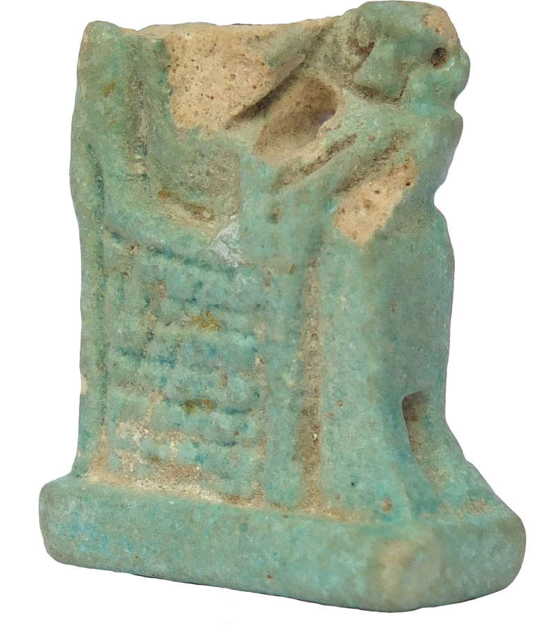 A fragmentary Egyptian faience amulet of Isis suckling Horus