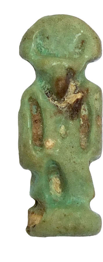 A small Egyptian faience amulet of a deity, after 600 B.C.