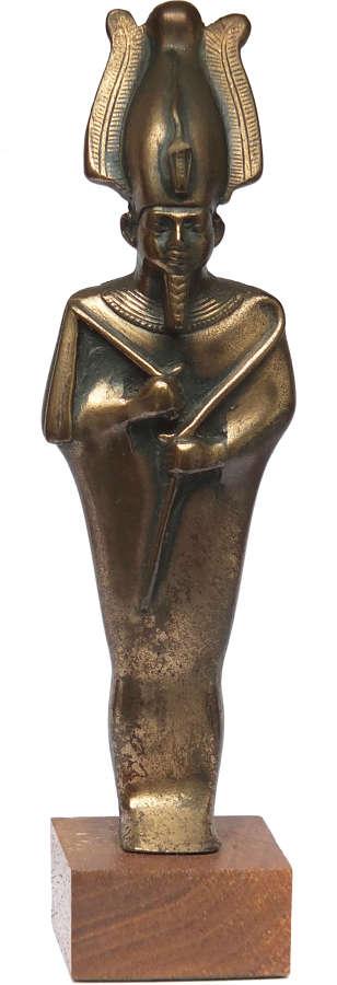 A fine Egyptian bronze standing figure of Osiris, c. 600 B.C.