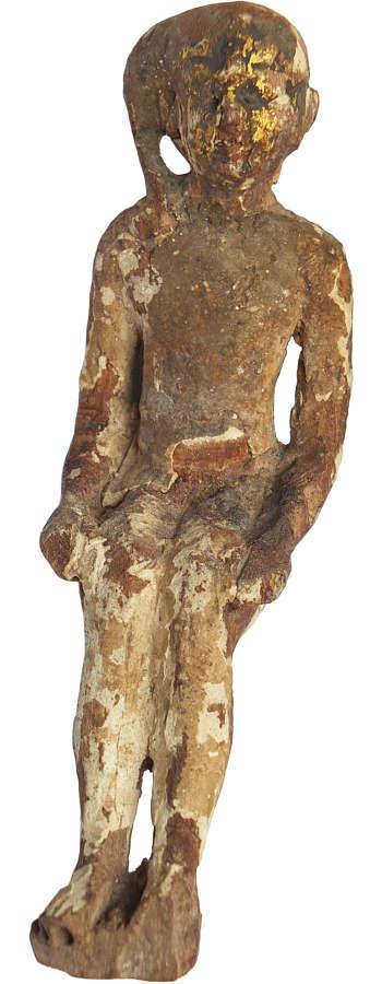 An Egyptian wooden figure of Harpocrates, c. 600-300 B.C.