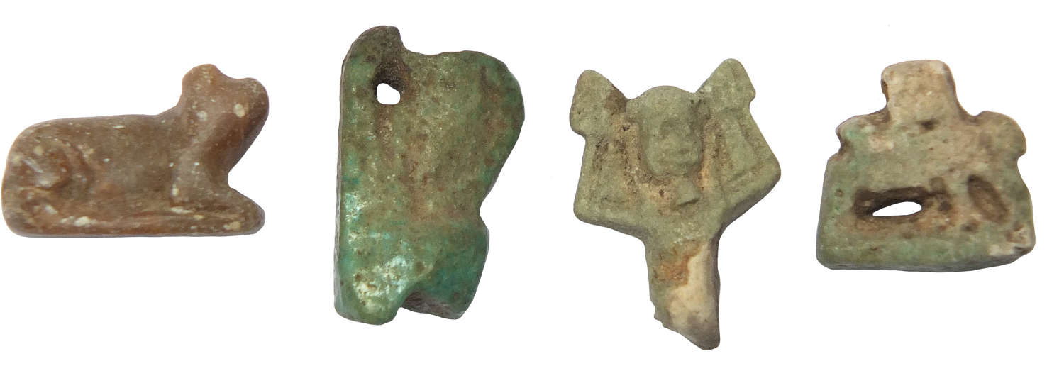 A group of four Egyptian amulets of degenerate type, Late Period