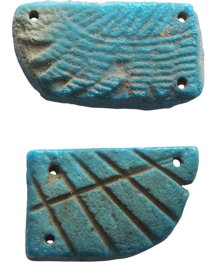 Two Egyptian unmatched faience scarab wings, c. 1st Millennium B.C.