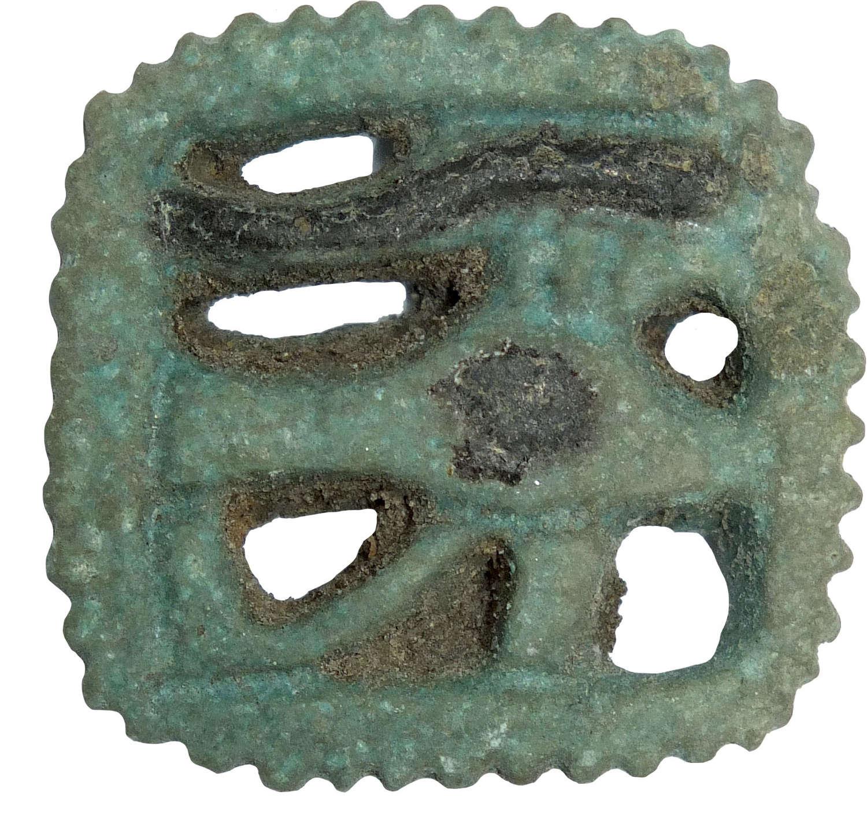 An Egyptian open-work udjat eye amulet, 1st Millennium B.C.