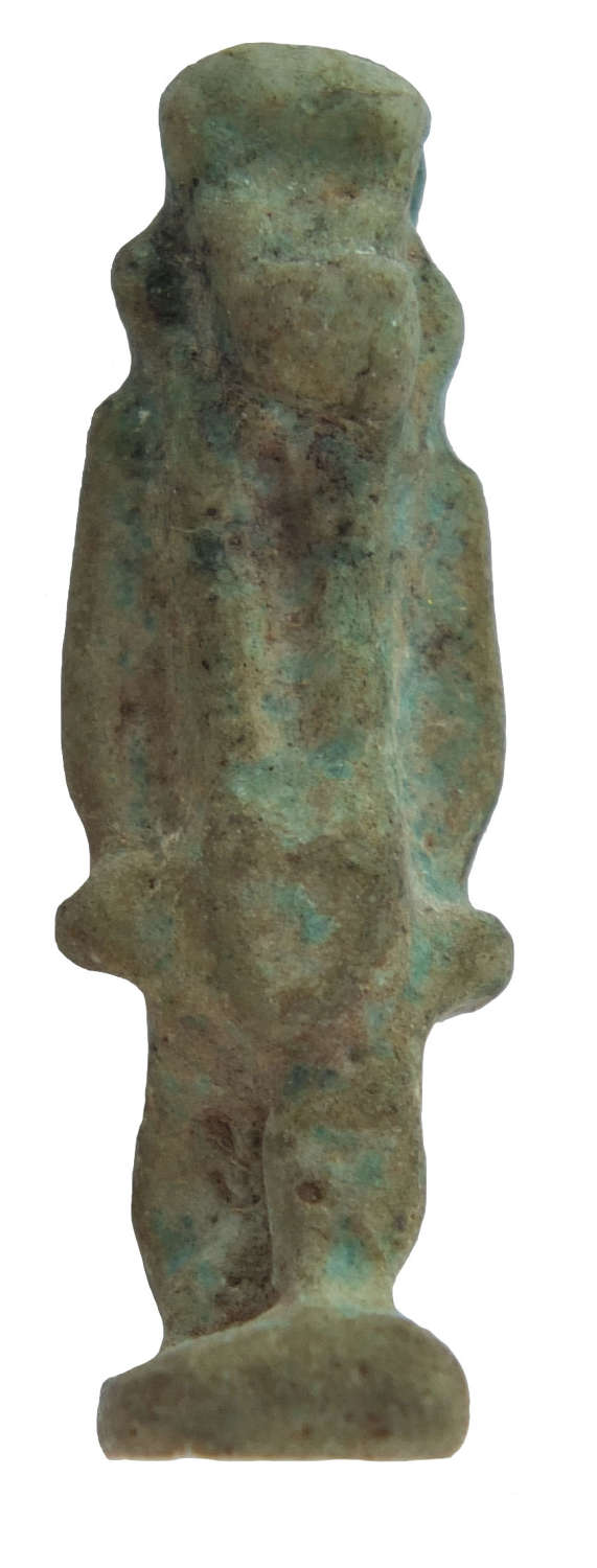 An Egyptian faience amulet of a deity, Late Period, c. 600-30 B.C.
