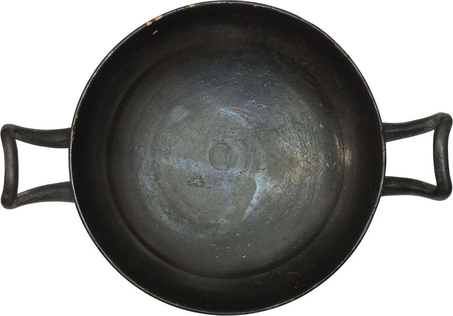 A Greek black glazed stemless kylix, 4th Century B.C.