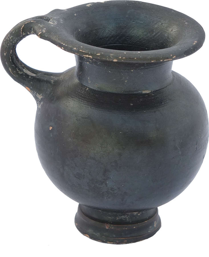 An elegant Greek black glazed cup, 4th Century B.C.