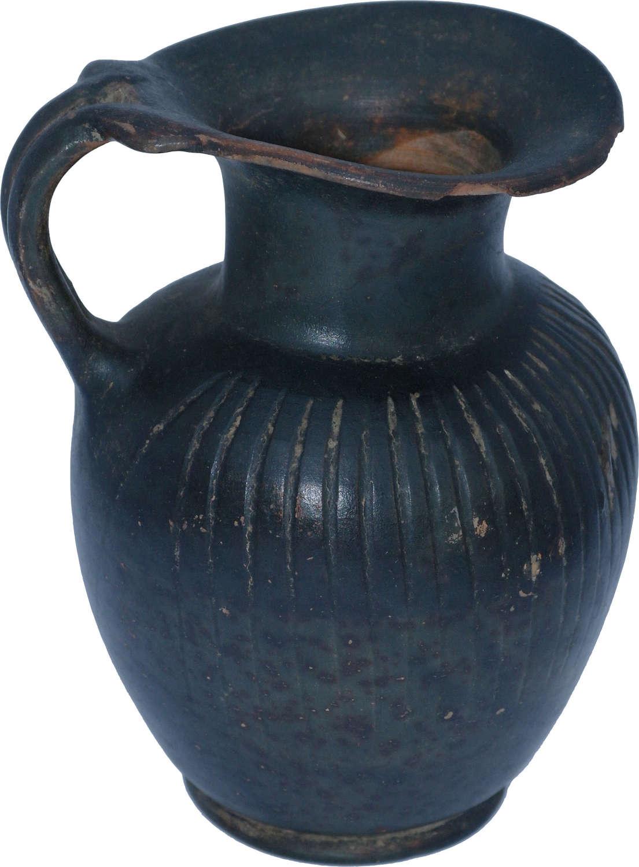 A good-sized Greek black glazed jug, 4th Century B.C.