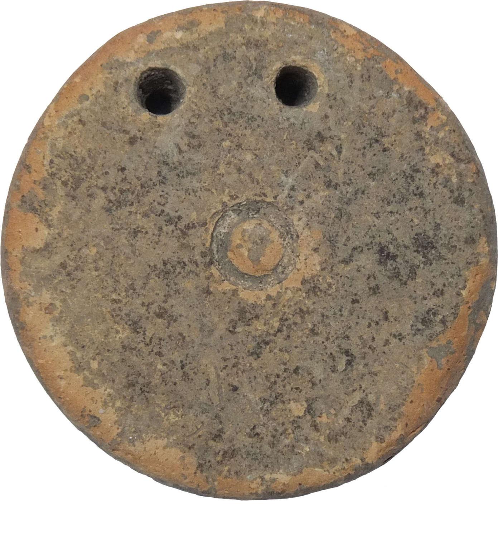 A Greek terracotta loom weight, c. 4th Century B.C.