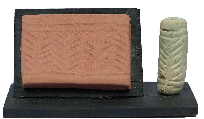 A Mesopotamian Jemdet Nasr cylinder seal, c. 3000 B.C.