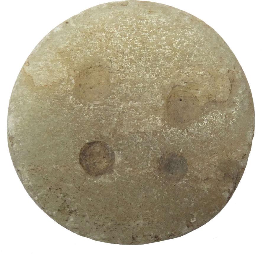 A Jemdet Nasr perforated circular stone stamp seal, c. 3000 B.C.