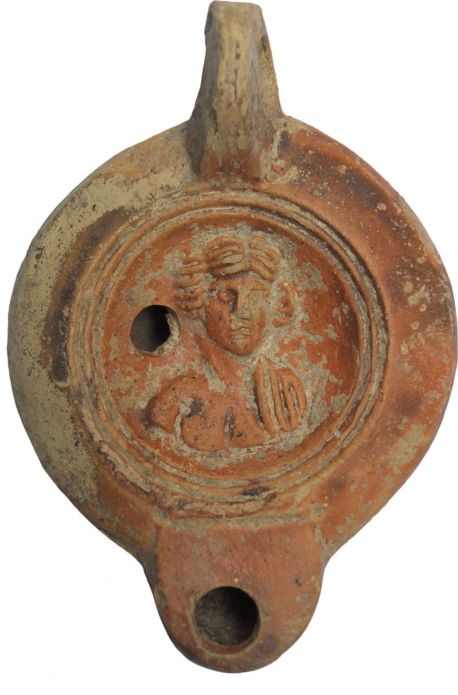 A Roman red-slipped terracotta oil lamp, c. 120–200 A.D.