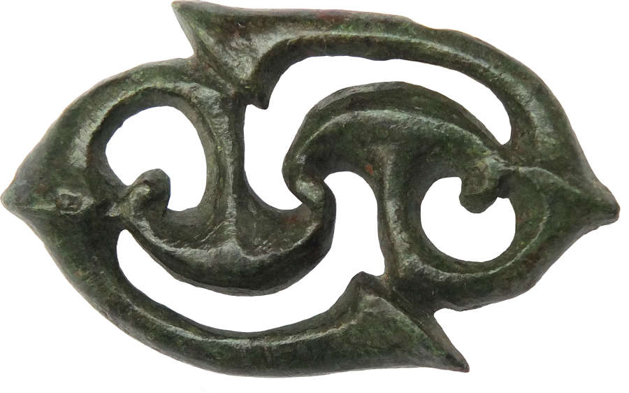 A Celtic bronze brooch in the form of conjoined war trumpets