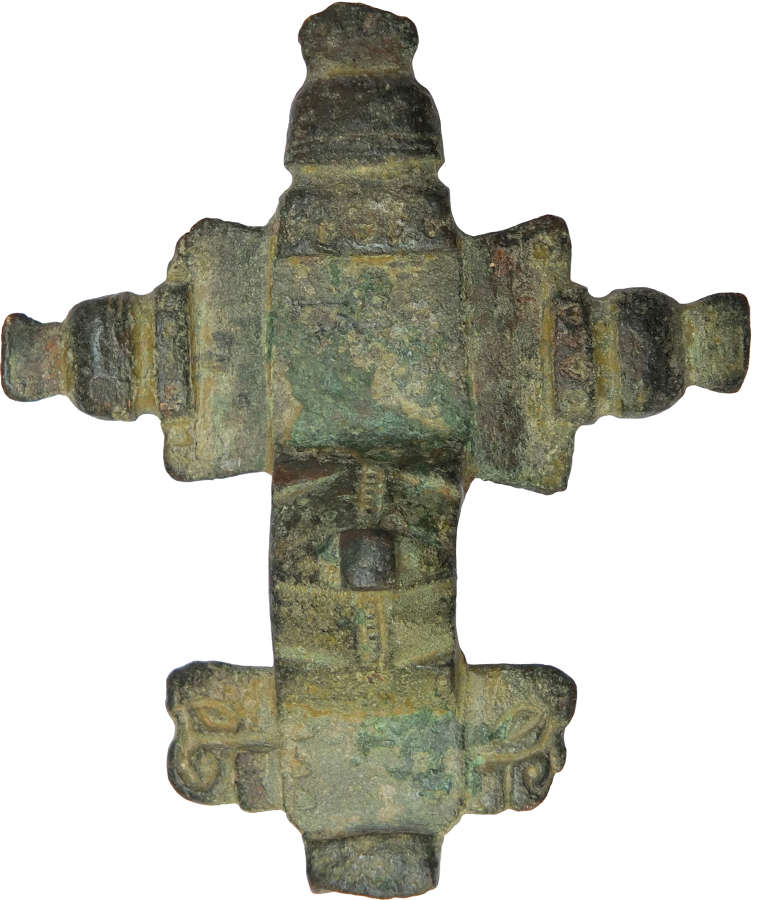 An incomplete Anglo-Saxon bronze cruciform brooch, c. 6th Century A.D.