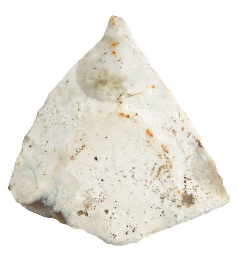 A Late Neolithic - Early Bronze Age barbed and tanged flint arrowhead