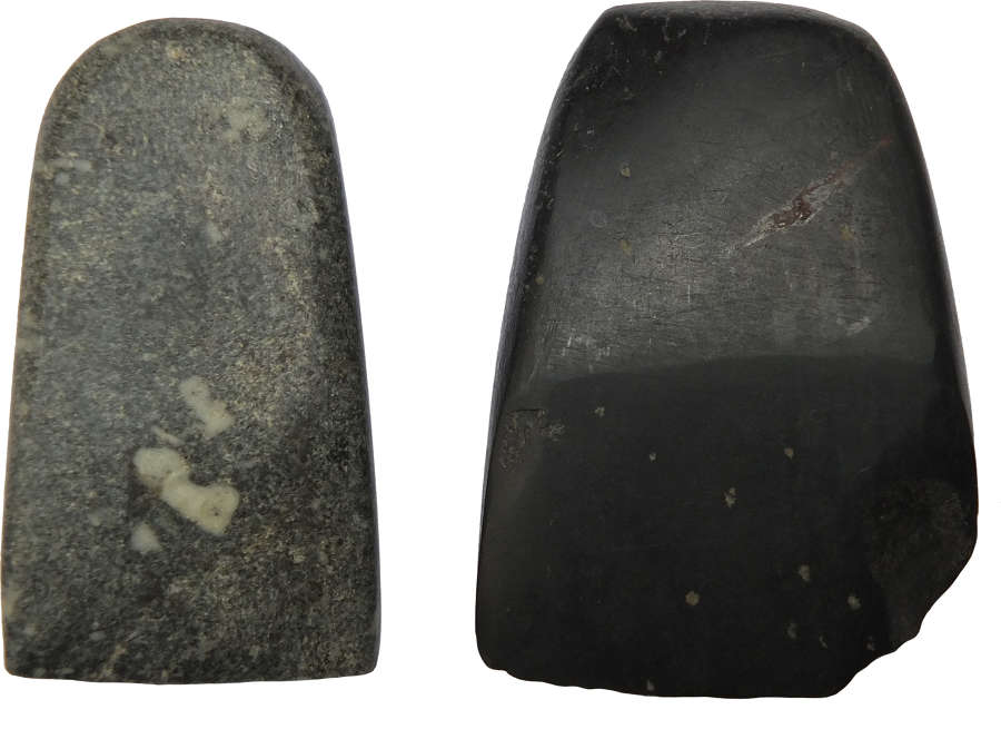 Two small dark stone polished axeheads