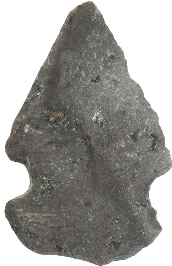A small North American Indian grey stone arrowhead