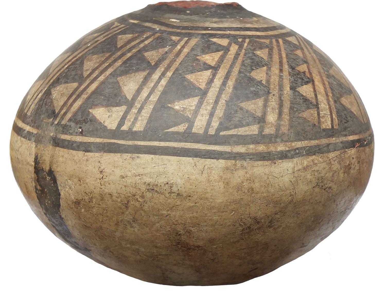 A globular Chancay sub-spherical pot, Peru, c. 1200-1450 A.D.