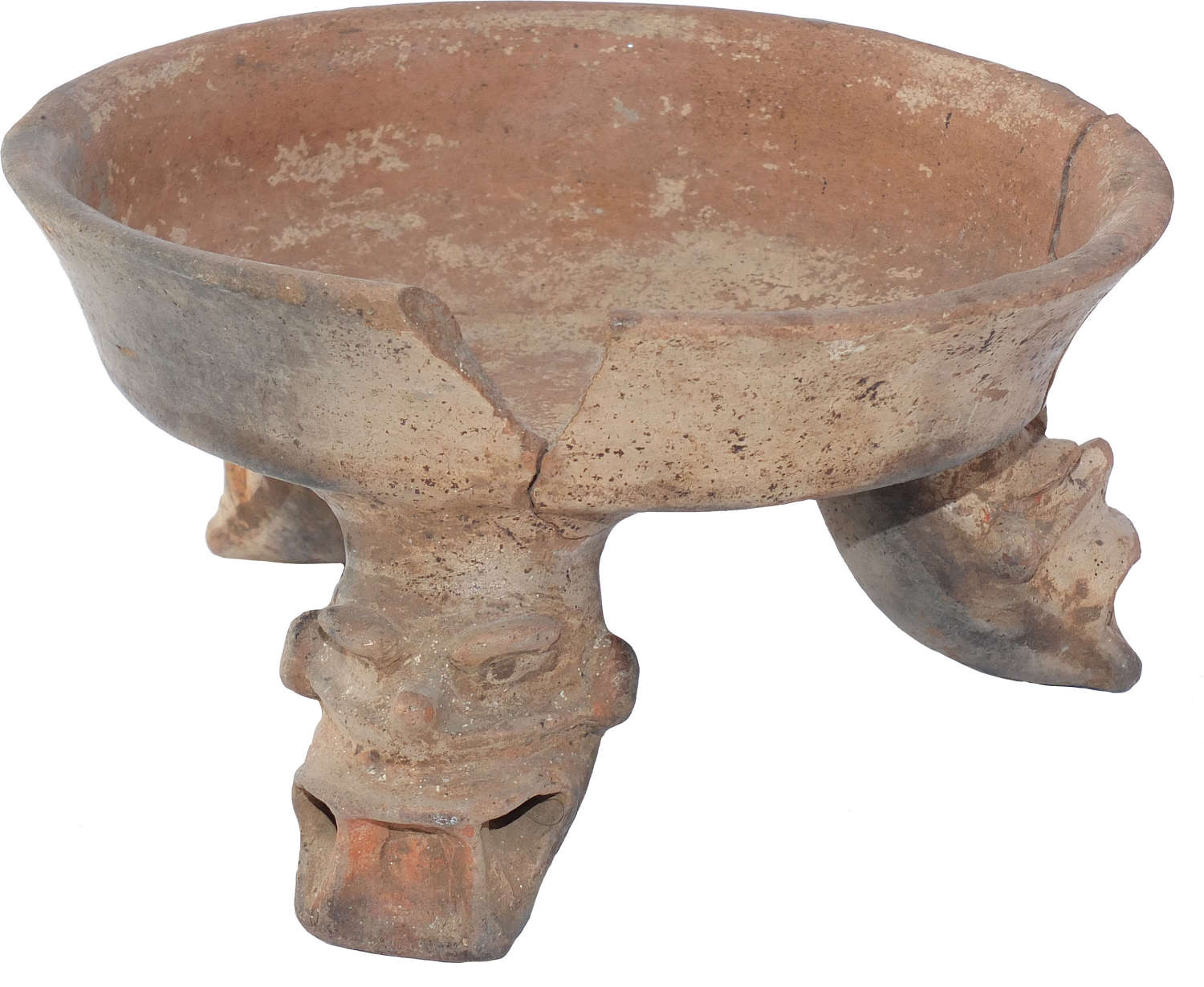 A Costa Rican tripod bowl with rattle legs modelled as demonic heads