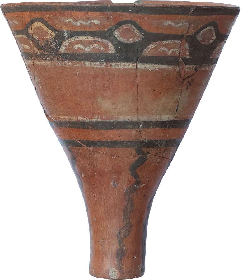 A Bolivian red ware kero, Tiahuanaco, c. 500-1000 A.D.