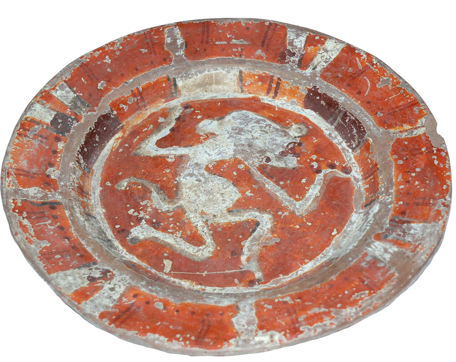 A painted Mixtec plate showing a dancing feline god, Mexico