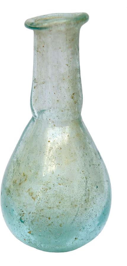 A small Roman pale blue glass unguentarium, c. 1st-2nd Century A.D.