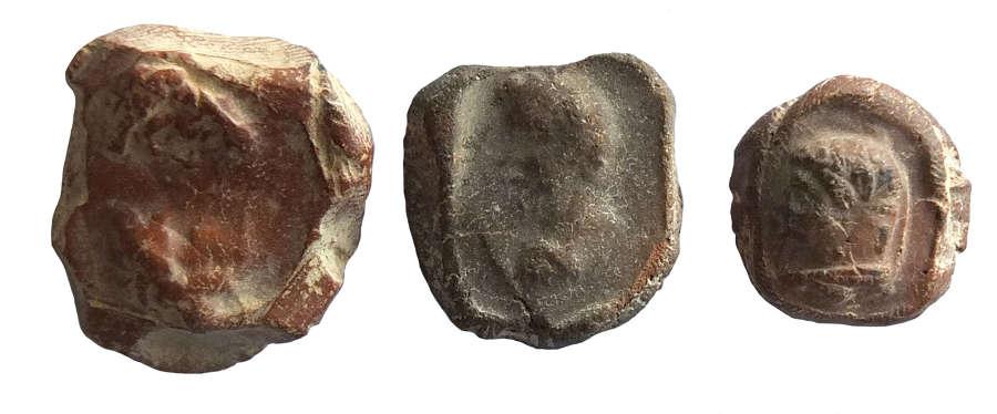 A group of three Roman terracotta bullae, c. 2nd - 3rd Century A.D.