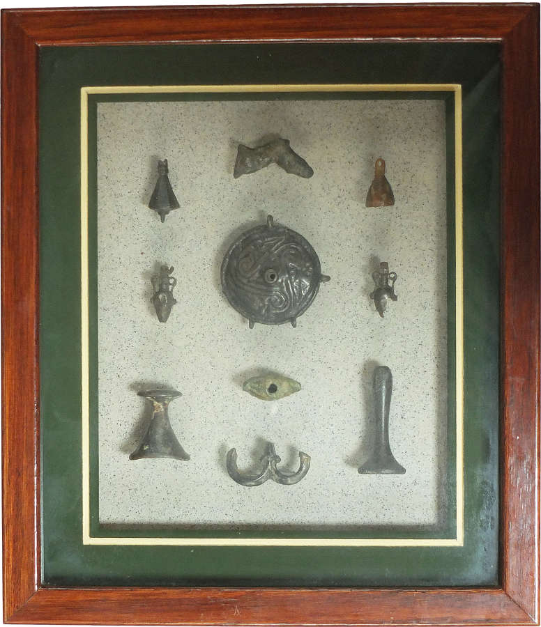 A framed group of ten Roman bronze fittings and attachments