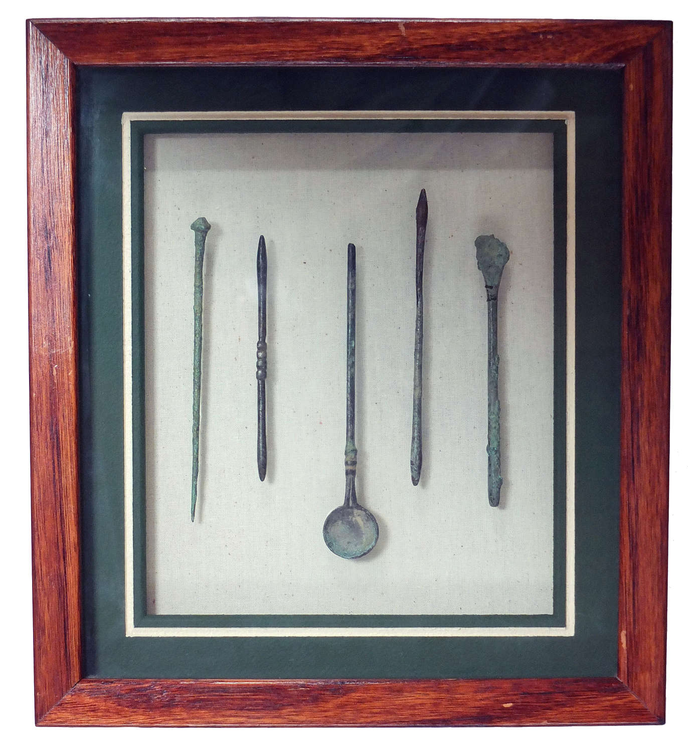 A framed group of five Roman medical/cosmetic tools