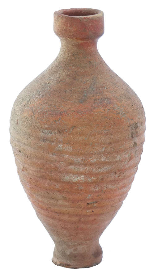 A Roman bottle in orange coarse ware, c. 3rd-4th Century A.D.