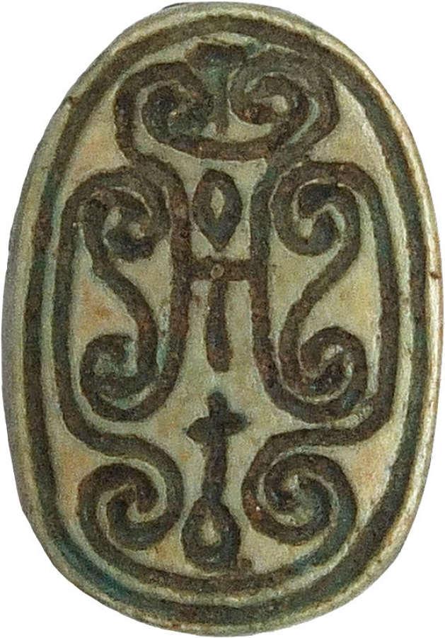 An Egyptian blue glazed steatite scarab, Hyksos, c. 1700-1550 B.C.