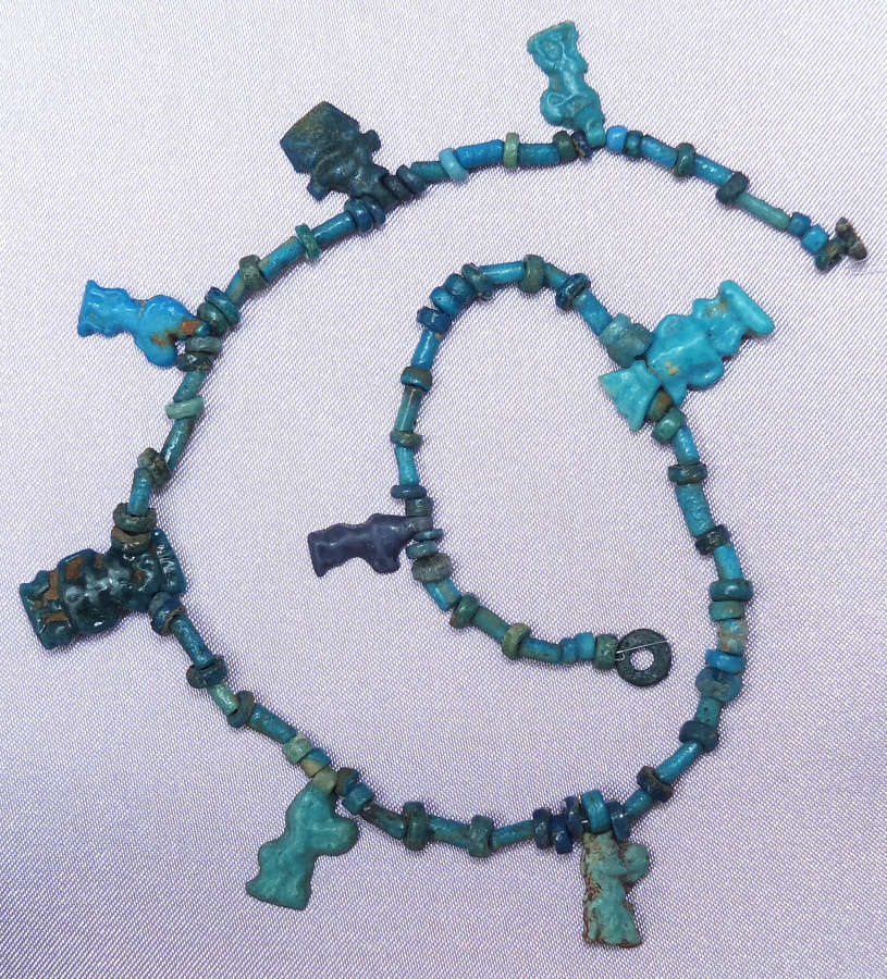 A length of ancient Egyptian beads with Amarna Period Bes pendants