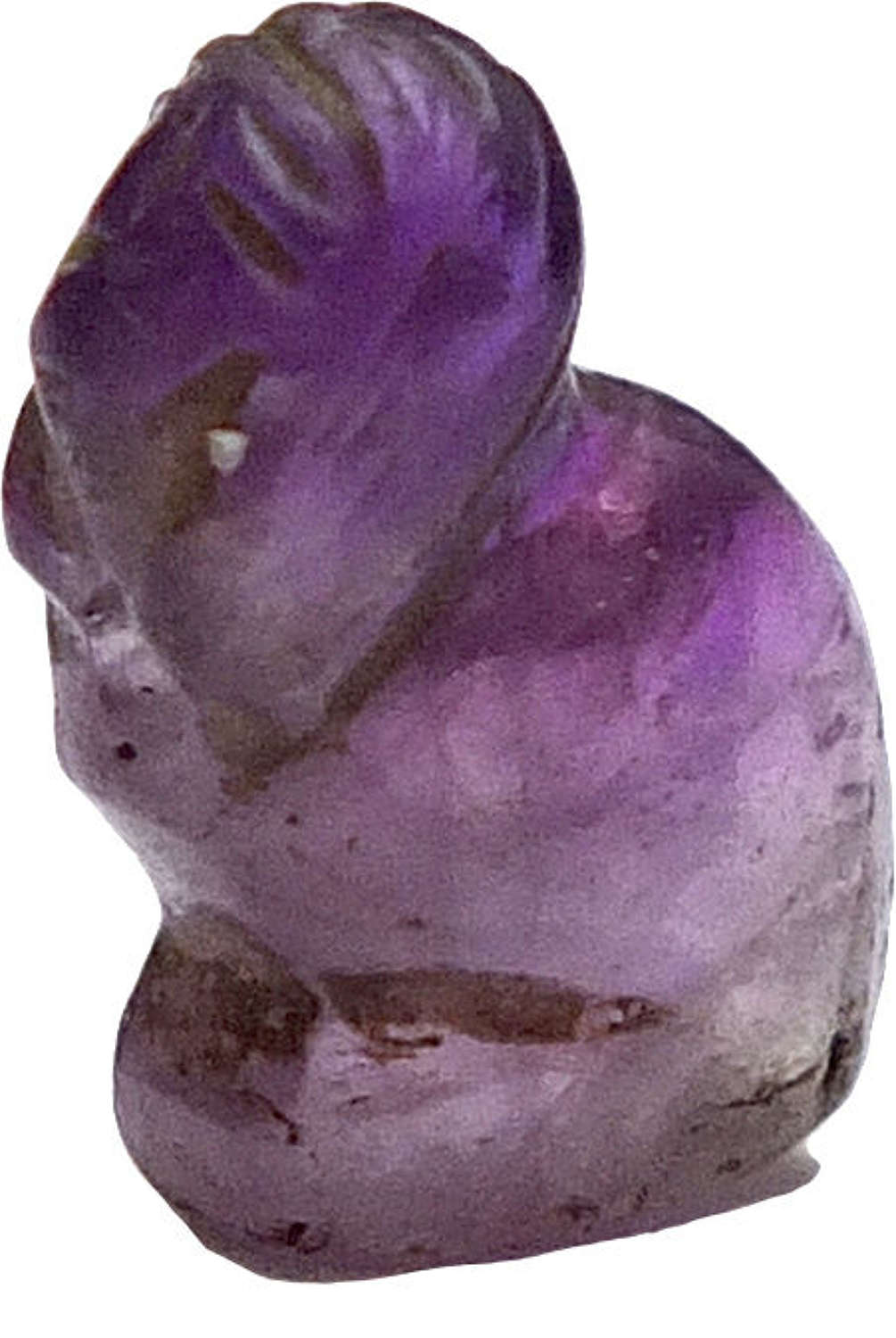 A small amethyst amulet of a crouching sphinx, c. 2055-1650 B.C.