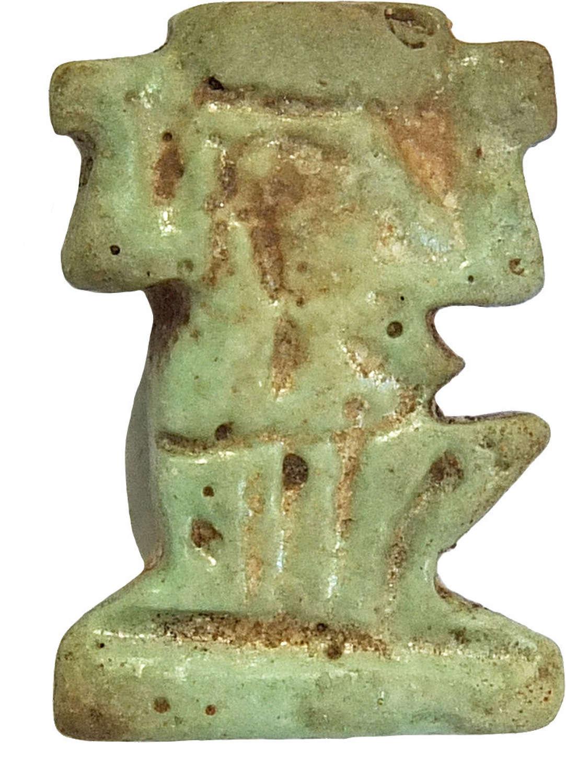 An Egyptian pale blue faience Shu amulet, c. 730-300 B.C.