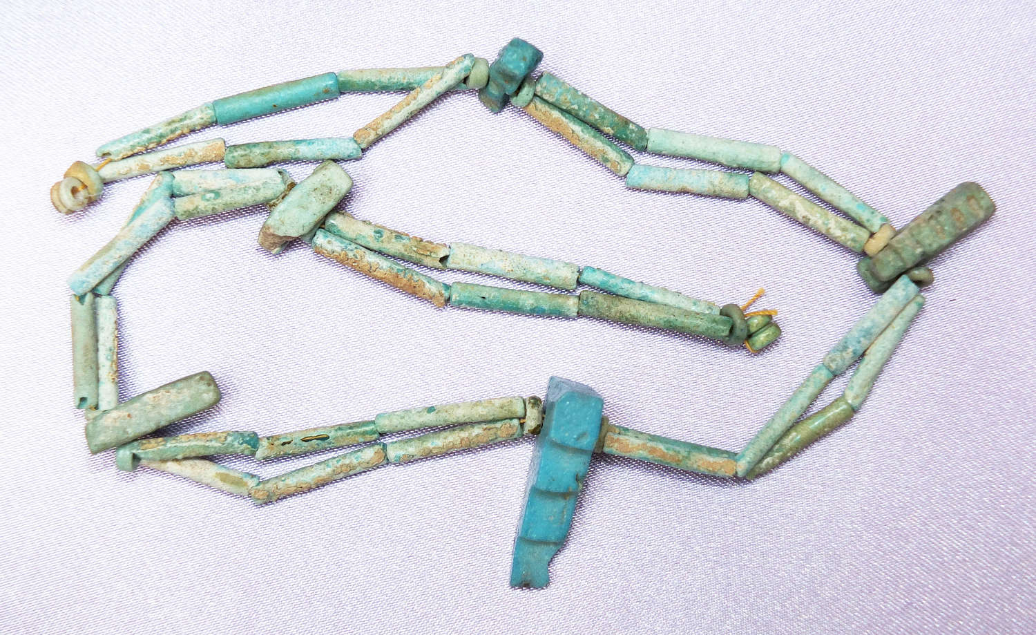A restrung necklace of Egyptian beads with rare staircase amulet