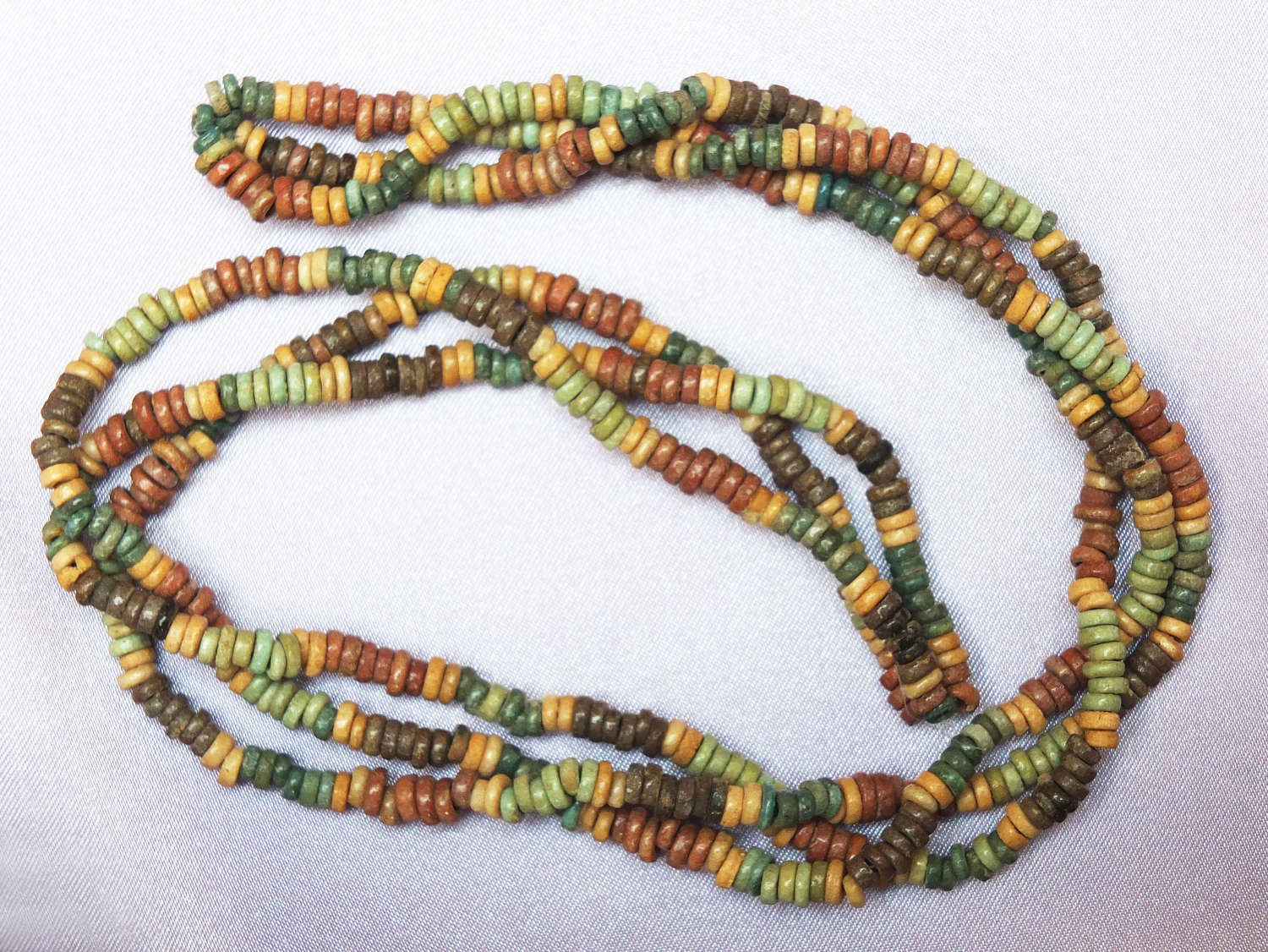 A restrung partially double-stranded necklace of Egyptian beads