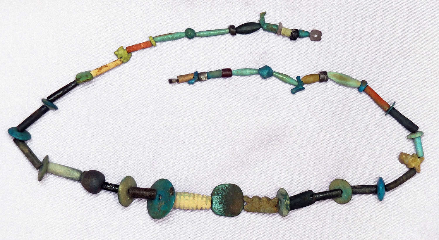A long restrung necklace of Egyptian faience beads of varied type