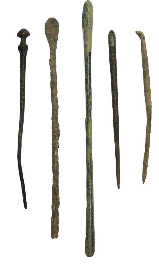 A group of five Roman bronze tools and pins, 1st - 4th Century A.D.