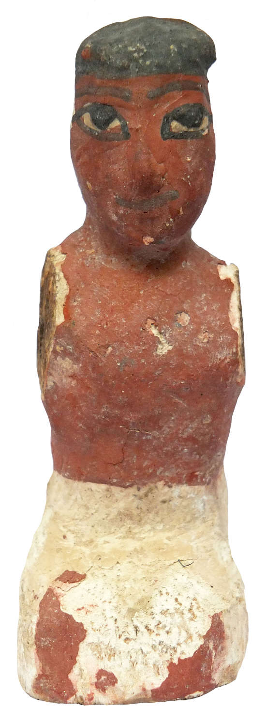 An Egyptian wooden figure, Middle Kingdom, c. 2000-1800 B.C.