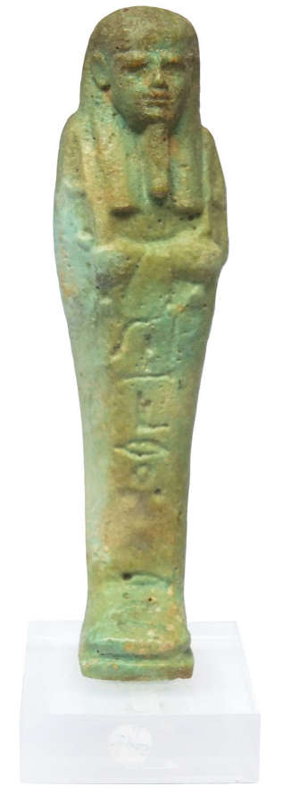 An Egyptian green glazed faience ushabti for Ankh-her, 664-525 B.C.