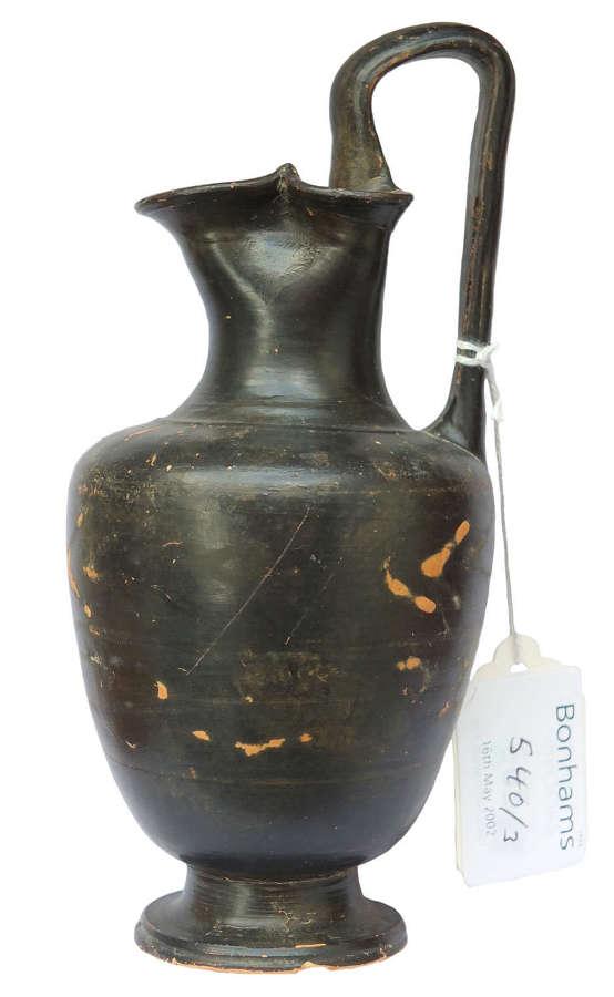 A small Greek South Italian black glazed oinochoe, 4th Century B.C.