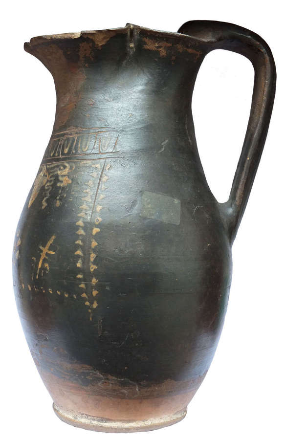 A Greek Gnathia Ware black glazed oinochoe, c. 4th Century B.C.